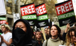 Thousands of students march through central London calling for an end to tuition fees and student cuts on 19 November 2014.