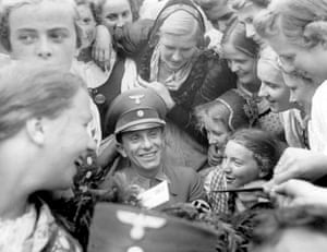 Goebbels with autograph hunters at the Nuremberg Rally in 1938.