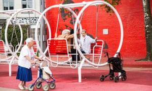 Older women use equipment in Superkilen, a public park in the Norrebro district of Copenhagen, Denmark.