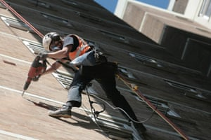 Industrial abseiler drilling building