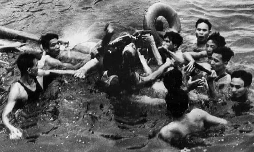 Photo released by the Vietnamese News Agency which is claimed to show the rescue on 26 October 1967 ago of then US navy pilot John McCain, centre, from Hanoi's Truc Bach lake.