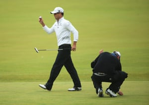 Zach Johnson acknowledges the crowd after making a birdie on the first playoff hole.