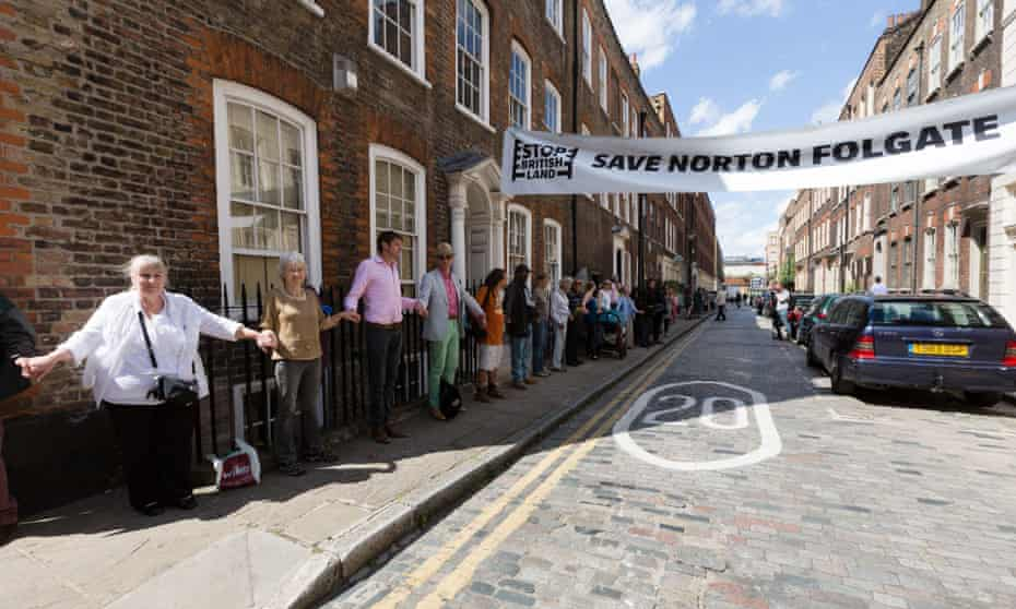 Activists from the 'Save Norton Folgate' campaign form a human chain around the area's historic buildings.