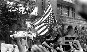 Demonstrators burn US flag outside the US embassy in Tehran.