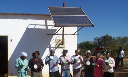 Members of the Gomba Agro-Business Centre showing off their solar lanterns.