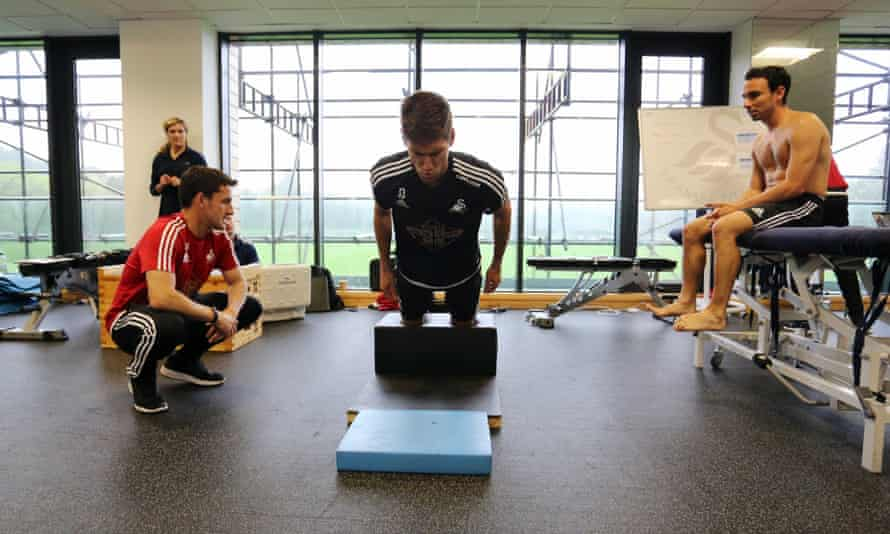 The Swansea defender Federico Fernández takes part in pre-season training on the NordBord, which tests hamstring strength.
