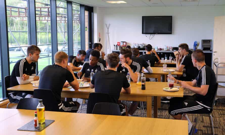 Swansea players have breakfast in the canteen at the training ground.