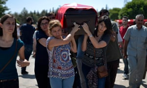 Friends and relatives carry the coffin of a victim of the Suruç bombing during a funeral in Gaziantep, Turkey, for 16 of the 32 people killed.