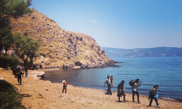 Refugees arrive on the beach in Lesvos.