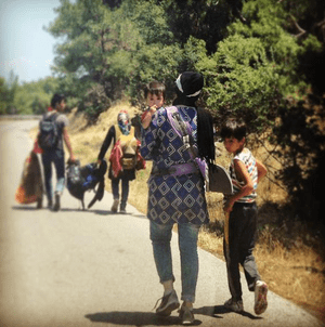 It's tough journey for kids and shade is scarce on the 70km route to the makeshift #refugee camp in Lesvos,