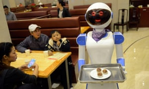 A server robot delivers food at a restaurant in Cixi, east China's Zhejiang Province