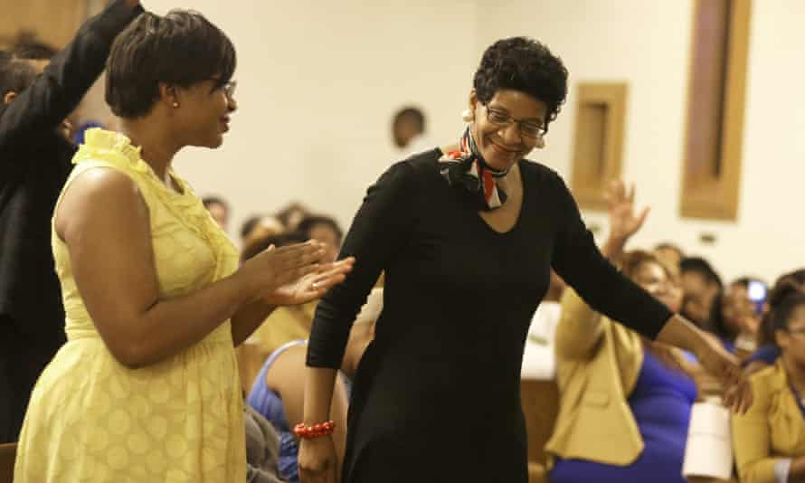Geneva Read Veal, right, and her daughter Sharon Cooper react to a prayer during a memorial service for Read Veal's other daughter Sandra Bland.