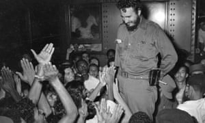 Fidel Castro is acclaimed by a group of young people, Cuba, circa 1960.