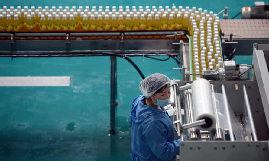 A North Korean operates a fruit juice factory on the outskirts of Pyongyang in 2012. To beat the brutal summer heat, the state has ordered workers to start at 5am.