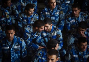 Members of the Iranian air force talk to each other while attending an Eid al-Adha prayer ceremony in Tehran.