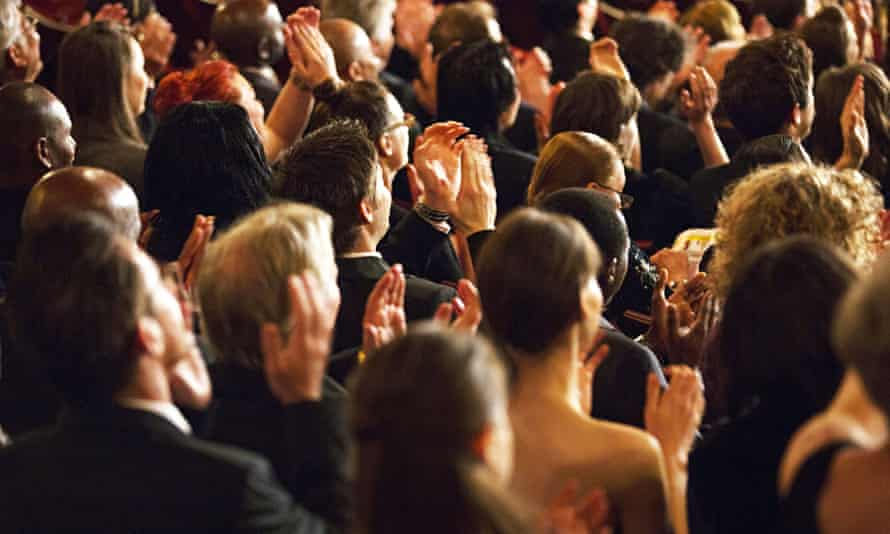Clapping concert audience