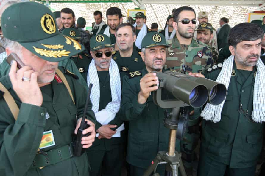 Revolutionary Guards commander Mohammad Ali Jafari monitors with binoculars during a war game in the Hormuz area of southern Iran.