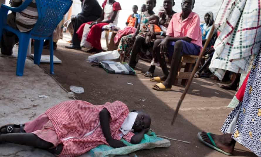 South Sudanese patients wait for medical treatment in the outpatient department of a medical camp.