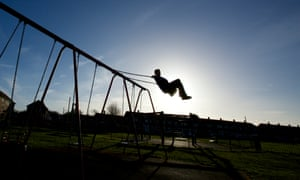 Child playing on swings.