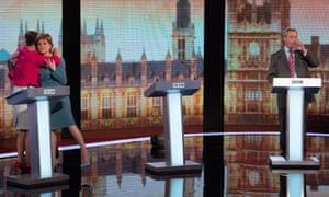 Plaid Cymru leader Leanne Wood, Green Party Leader Natalie Bennett and SNP leader Nicola Sturgeon share a hug UKIP leader Nigel Farage sips his drink after taking part in the Live BBC Election Debate 2015