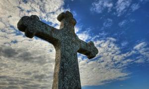 A Christian cross against the sky