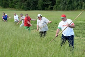 Depardieu joins the president in scything grass