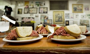 Smoked meat sandwiches sit on the counter at Schwartz's deli in Montreal, Canada