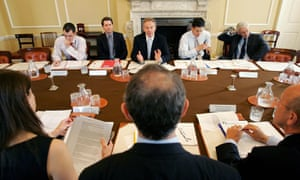 Justin Forsyth (second left) sits next to Tony Blair during his days working for the Labour prime minister in 2006.