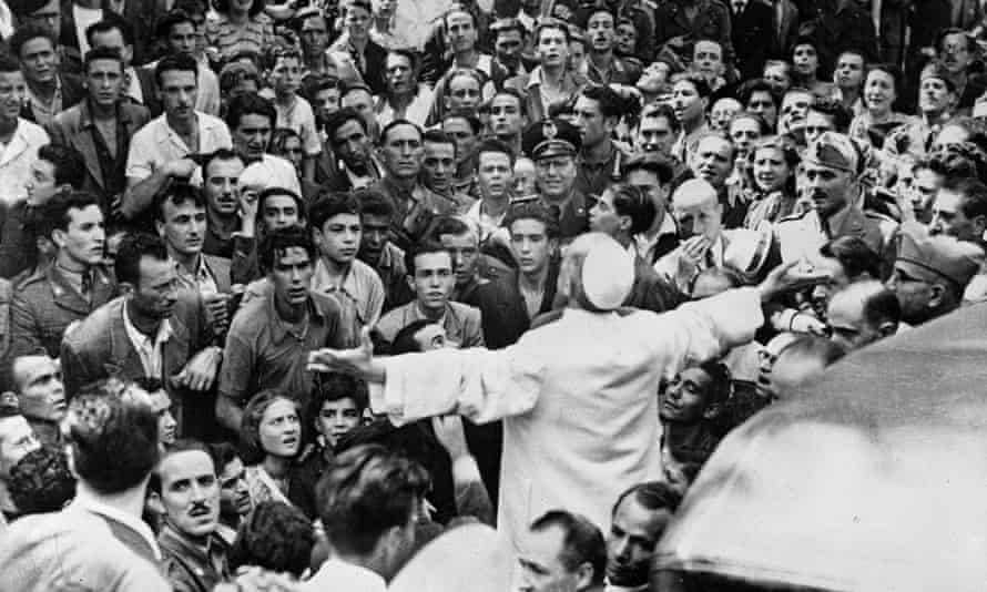 Pope Pius XII in the middle of the crowd, during the bombardment of the basilica Saint Laurent, in Rome, July 1943. Photograph: Photograph: Roger-Viollet/REX Shutterstock