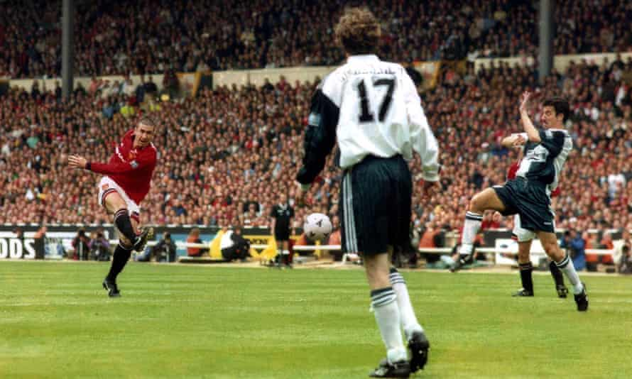 Manchester United's Eric Cantona scores the only goal of the 1996 FA Cup final against Liverpool.