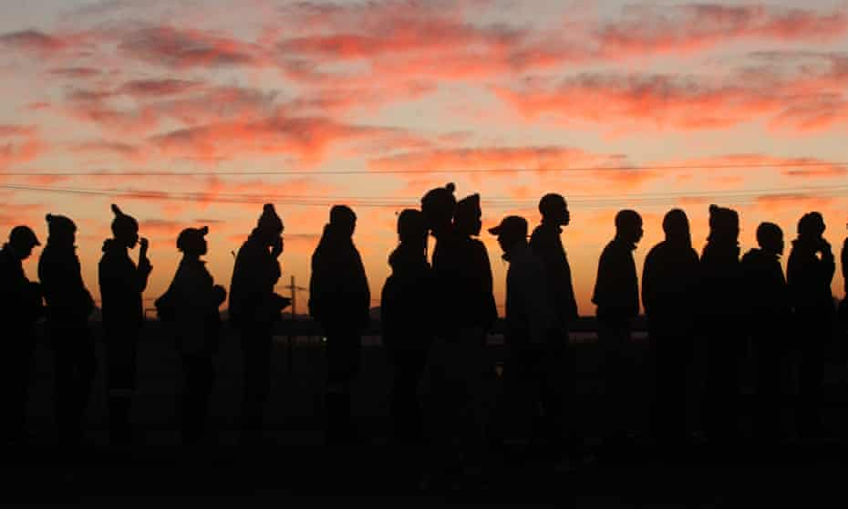 Platinum mineworkers report for work in Marikana, South Africa, after the end of a strike in 2014.