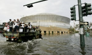 A National Guard truck takes residents through floodwaters to the Superdome.