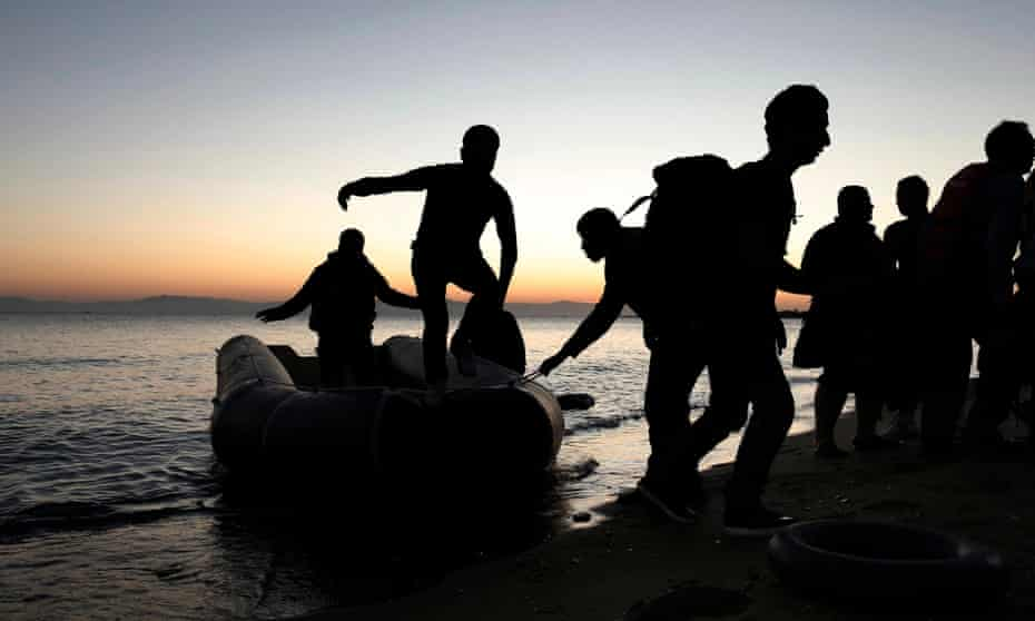 Syrian refugees disembark from a dinghy on the Greek island of Kos.
