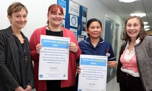Campaigners Nicci Gerrard and Julia Jones with Jo James, lead nurse for dementia medicine, and Josephine Tapit, ward manager, at St Mary's Hospital, Paddington, London.
