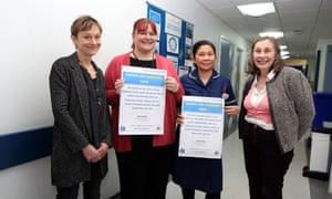 Nicci Gerrard, left, and Julia Jones, right, who are campaigning to get recognition for carers of dementia patients in hospitals, with Jo James (lead nurse for dementia medicine for elderly) and Josephine Tapit (ward manager) at St Mary's Hospital in Paddington, London.