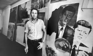 Artist Robert Rauschenberg standing in front of his painting of President John Kennedy.