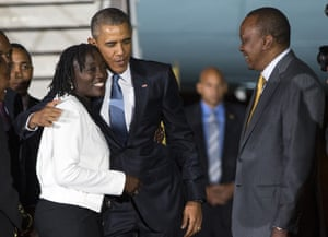 Obama hugs his half-sister Auma Obama on arrival.