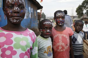 "Children with painted faces that read ""Obama is coming"" and ""Raila is Baba"" at Kamukunji Grounds in Kibera."