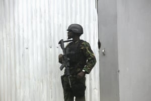 A soldier patrols outside the hotel where Obama is staying in Nairobi.