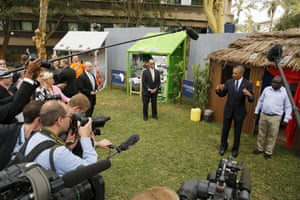 Obama addresses the media while talking with solar power businesspeople at the Power Africa Innovation Fair at the UN compound.