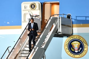 Barack Obama alighting from Air Force One.