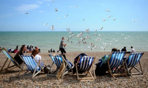 Under attack: tourists on the seafront at Hove.