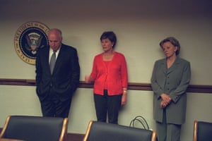 Cheney stands with his wife, Lynne (right), and the First Lady, Laura Bush.