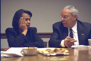 Nationoal security adviser, Condoleezza Rice, talks with Powell.