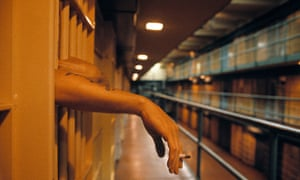 prison cell smoking cigarette