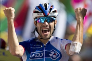 Thibaut Pinot of France celebrates as he crosses the finish line to win the twentieth stage.