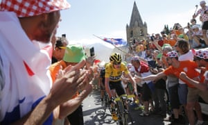 Britain's Chris Froome, wearing the overall leader's yellow jersey, climbs towards Alpe d'Huez.