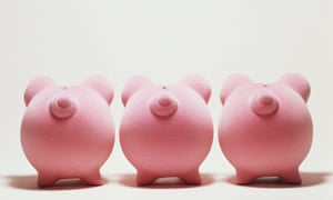 Three pink piggy banks in a row