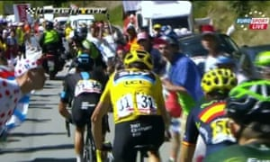 A 'fan' leans in and spits on Chris Froome during stage 20 on Alpe d'Huez.