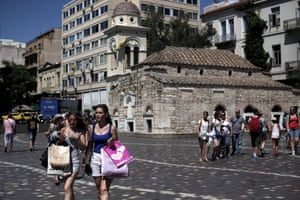 People make their way on Monastiraki square in central Athens, Greece July 19, 2015